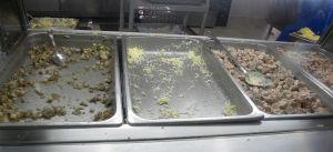 Empty bins of food