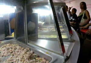 People ordering arepas