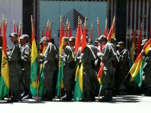 Bolivian soldiers with flags