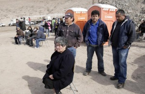 Miners' families wait