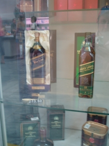 Johnny Walker Blue and Johnny Walker Green in store window, Havana, Cuba