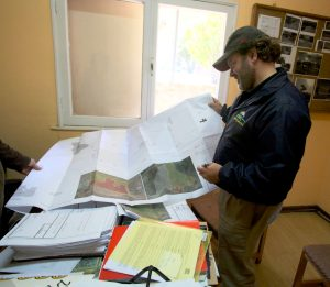 Ken Johnson, head of Galt's Gulch Chile, looks at proposed subdivision map at Curacaví city hall.